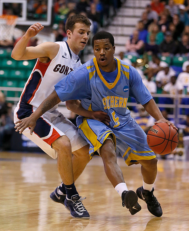 . Southern\'s Jameel Grace, right, drives past Gonzaga\'s Kevin Pangos in the first half during a second-round game in the NCAA college basketball tournament in Salt Lake City, Thursday, March 21, 2013. (AP Photo/George Frey)