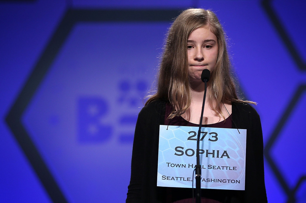 . NATIONAL HARBOR, MD - MAY 30:  Sophia Limacher of Seattle, Washington, reacts after she misspelled her word in the round five of the 2013 Scripps National Spelling Bee May 30, 2013 at Gaylord National Resort and Convention Center in National Harbor, Maryland. Forty-two have advanced to the semifinal of the annual spelling contest for the championship.  (Photo by Alex Wong/Getty Images)
