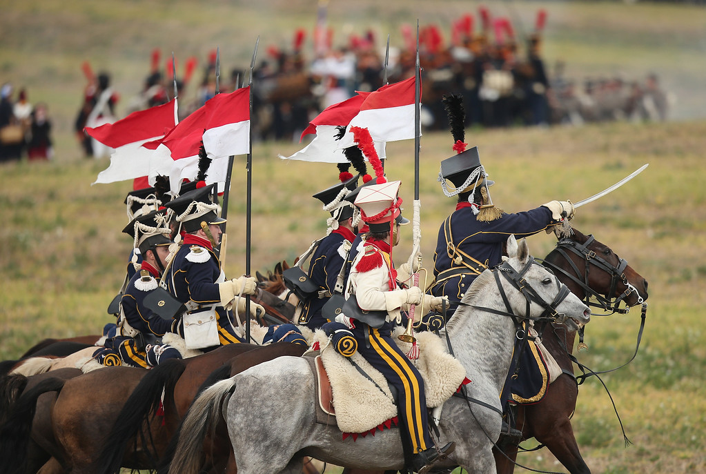 . Historical society enthusiasts in the role of Polish lancers loyal to Napoleon advance during the re-enactment of The Battle of Nations on its 200th anniversary on October 20, 2013 near Leipzig, Germany. (Photo by Sean Gallup/Getty Images)
