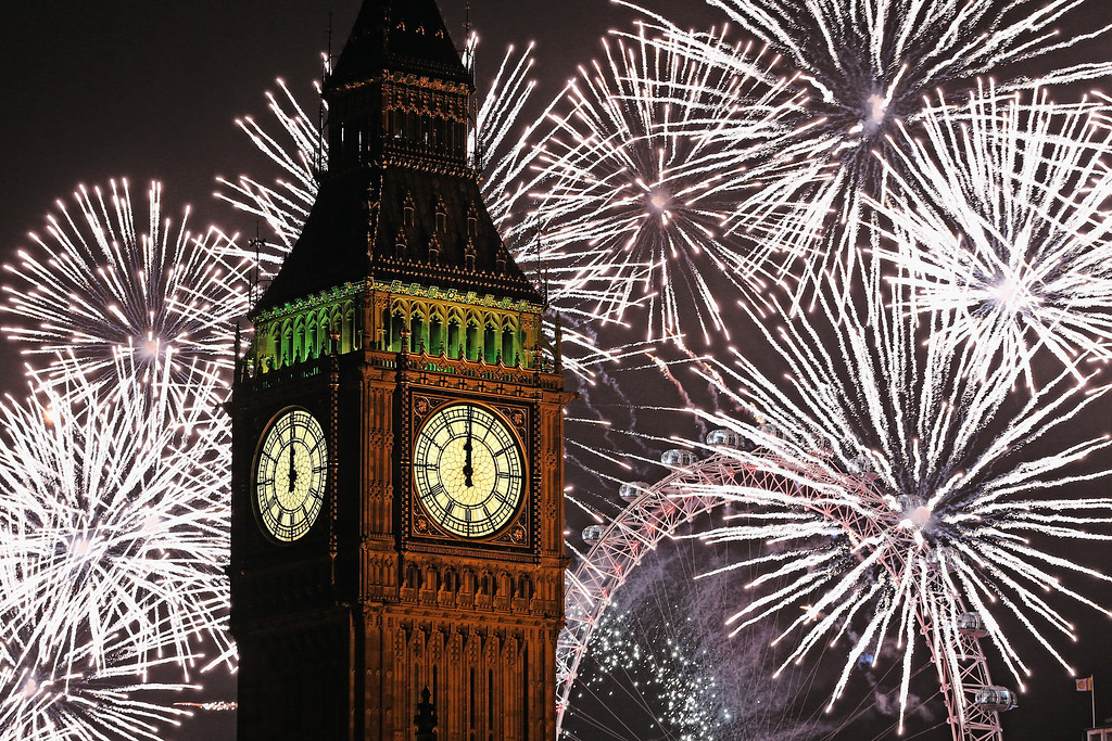 . LONDON, ENGLAND - JANUARY 01:  Fireworks light up the London skyline and Big Ben just after midnight on January 1, 2014 in London, England. Thousands of people lined the banks of the River Thames in central London to see in the New Year with a spectacular fireworks display.   (Photo by Dan Kitwood/Getty Images)