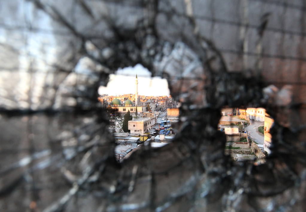 . FILE - Bullet holes are seen in a window in Tripoli, Lebanon, Saturday, Feb. 11, 2012. Clashes between pro- and anti-Syria gunmen in the northern Lebanese city of Tripoli left two people dead and 12 wounded in the latest skirmish between Lebanese factions over the crisis in neighboring Syria. (AP Photo/Bilal Hussein, File)