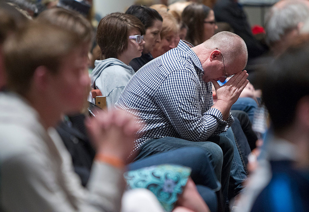 . People gathered to mourn the victims of the shooting at the Jewish Community Center and Village Shalom during a vigil  Sunday night at St. Thomas The Apostle Episcopal Church in Overland Park. Many of those in attendance were students from Blue Valley High School where Reat Underwood, one of the victims, was a student. (TAMMY LJUNGBLAD/The Kansas City Star)