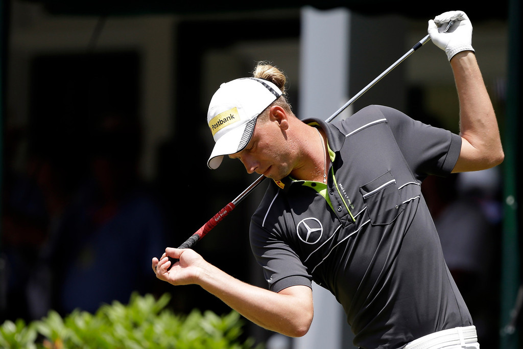 . Marcel Siem, of Germany, stretches before teeing off on the first hole during the third round of the U.S. Open golf tournament at Merion Golf Club, Saturday, June 15, 2013, in Ardmore, Pa. (AP Photo/Darron Cummings)