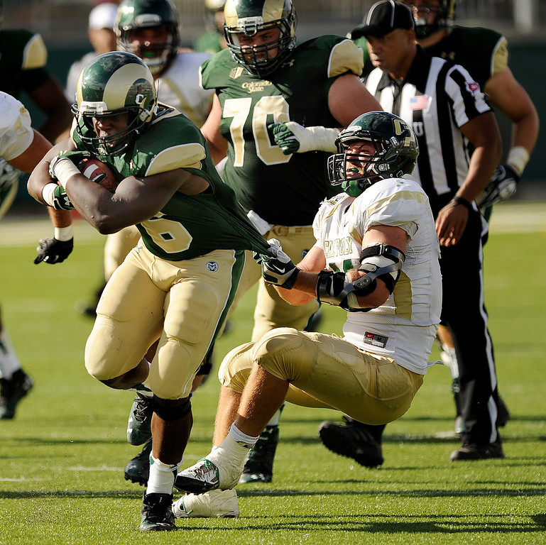 . FORT COLLINS, CO. - SEPTEMBER 14: Cal Poly defender Nick Dzubnar (41) dragged down Rams running back Chris Nwoke (6) in the fourth quarter. The Colorado State University football team defeated Cal Poly at Hughes Stadium in Fort Collins Saturday afternoon, September 14, 2013.  It was the Rams\' first home game and first win of the season. Photo By Karl Gehring/The Denver Post