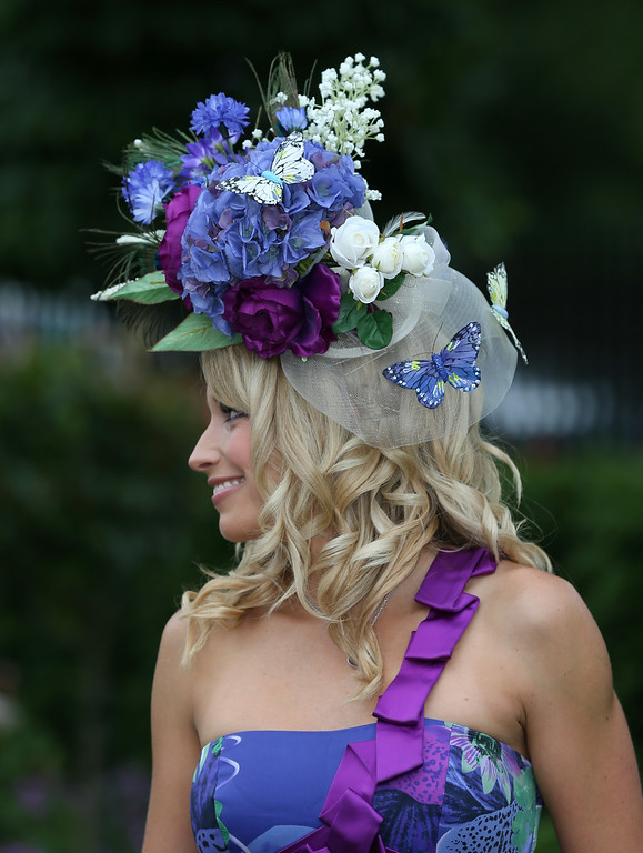 . A Lady racegoer wearing a floral hat on day three of Royal Ascot at Ascot Racecourse on June 19, 2014 in Ascot, England. (Photo by Steve Bardens/Getty Images)