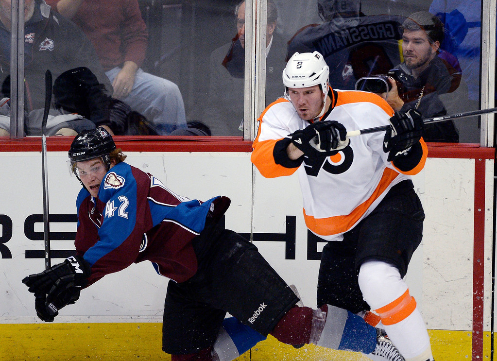 . Philadelphia Flyers defenseman Nicklas Grossmann (8) knocks Colorado Avalanche center Brad Malone (42) to the ice after a hit during the second period January 2, 2014 at Pepsi Center. (Photo by John Leyba/The Denver Post)