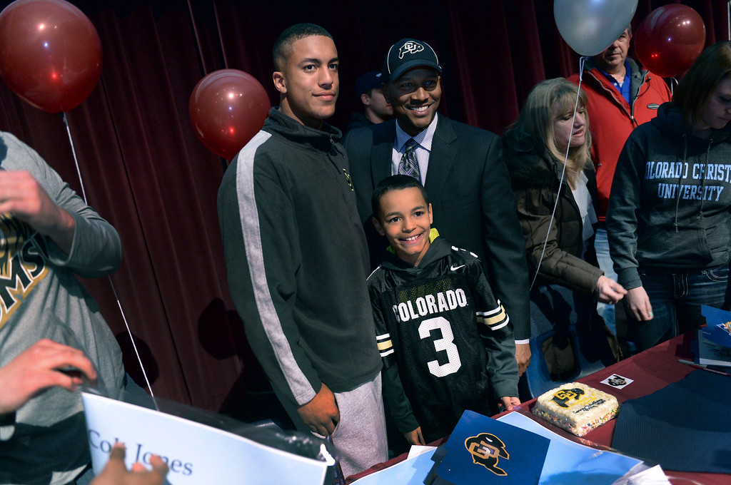 . AURORA, CO. - FEBRUARY 4: Cherokee Trail senior Evan White posed for photographs with his father Wayman and little brother Jaylen at the conclusion to a ceremony at school Wednesday. White, who played safety at CT, committed to play football at the University of Colorado. Cherokee Trail High School honored dozens of athletes on National Signing Day as seniors made final commitments to colleges in return for athletic scholarships Wednesday afternoon, February 5, 2014. Photo By Karl Gehring/The Denver Post
