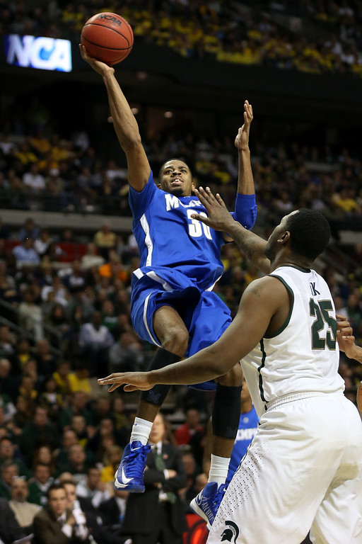 . AUBURN HILLS, MI - MARCH 23:  D.J. Stephens #30 of the Memphis Tigers drives for a shot attempt in the first half against Derrick Nix #25 of the Michigan State Spartans during the third round of the 2013 NCAA Men\'s Basketball Tournament at The Palace of Auburn Hills on March 23, 2013 in Auburn Hills, Michigan.  (Photo by Jonathan Daniel/Getty Images)