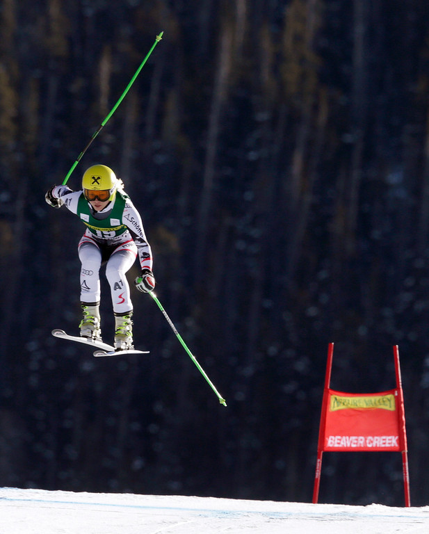 . Austria\'s Anna Fenninger flies over the last jump during the women\'s World Cup Downhill skiing event, Friday, Nov. 29, 2013, in Beaver Creek, Colo. Fenninger finished in fifth place. (AP Photo/Charles Krupa)