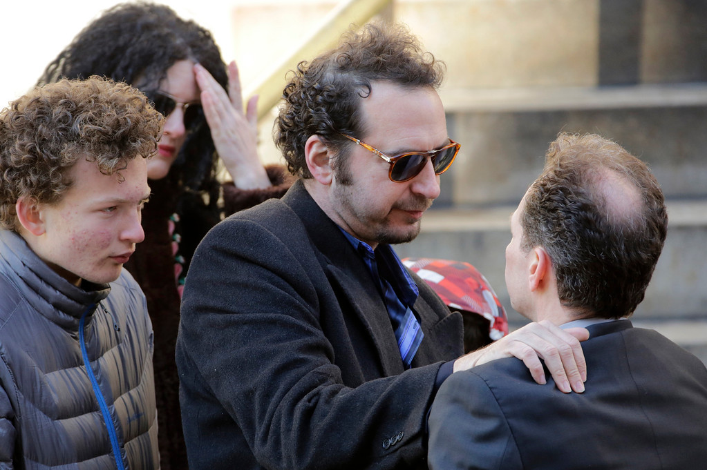 . David Bar Katz, center, a friend of actor Philip Seymour Hoffman, arrives for the actor\'s funeral at the Church of St. Ignatius Loyola, Friday, Feb. 7, 2014 in New York. Hoffman, 46, was found dead Sunday of an apparent heroin overdose. (AP Photo/Mark Lennihan)