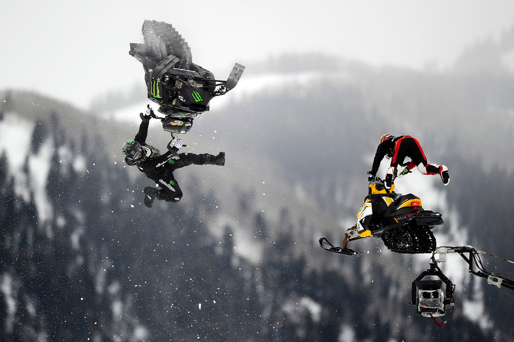 . ASPEN, CO - January 26: From left, Joe Parsons and Willie Elam go off the first jump in the bronze medal match of Snowmobile Speed & Style final at Winter X Games Aspen 2013 at Buttermilk Mountain on Jan. 26, 2013, in Aspen, Colorado. The pair finally raced after two false starts for tangling in the first turn. (Photo by Daniel Petty/The Denver Post)