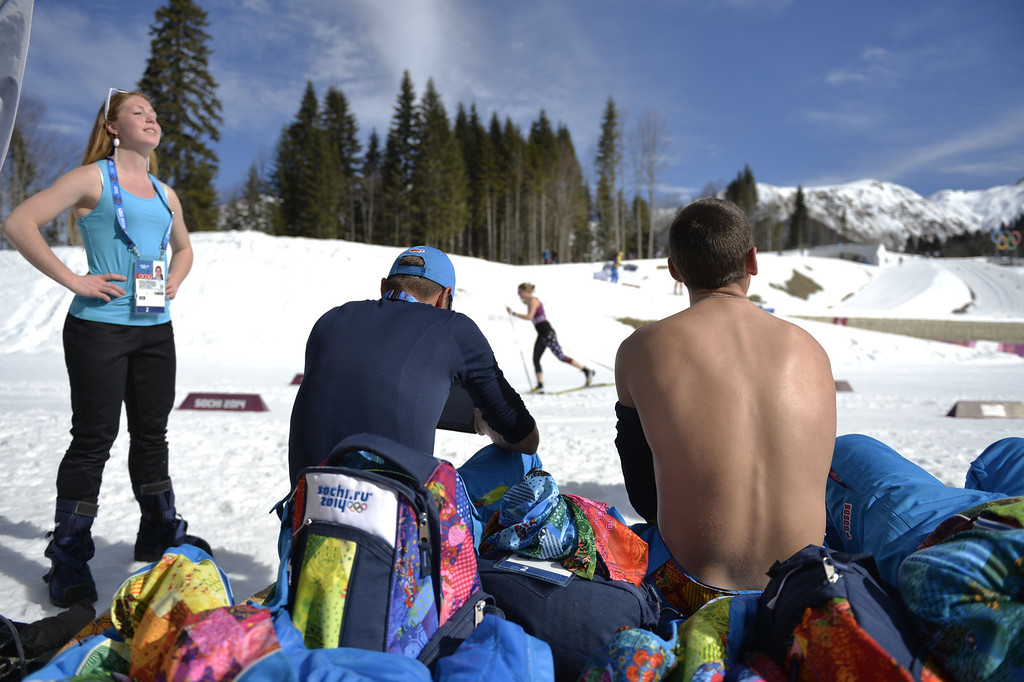 . Course preparators enjoy a sunbath before the Men\'s Cross-Country Skiing 15km Classic at the Laura Cross-Country Ski and Biathlon Center during the Sochi Winter Olympics on February 14, 2014. ODD ANDERSEN/AFP/Getty Images