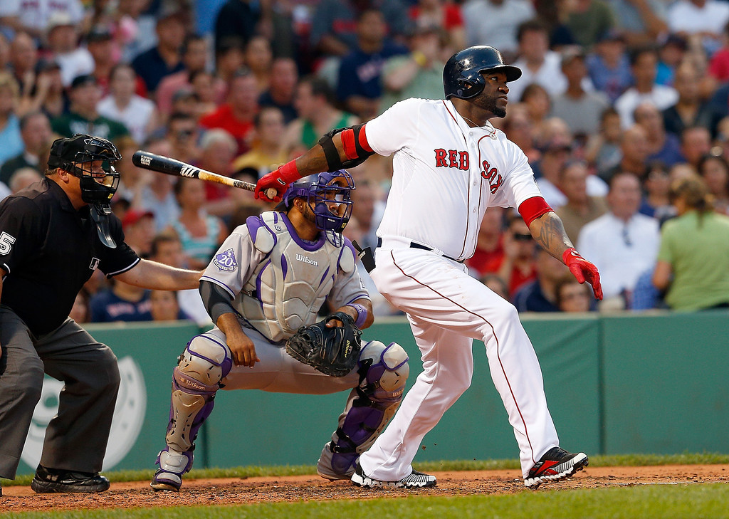 . David Ortiz #34 of the Boston Red Sox doubles to knock in a run against the Colorado Rockies in the 2nd inning at Fenway Park on June 25, 2013 in Boston, Massachusetts.  (Photo by Jim Rogash/Getty Images)