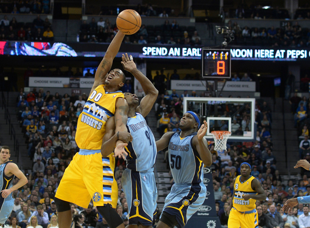 . DENVER, CO. - JANUARY 03:  Denver forward Darrell Arthur (00) fought for a loose ball with Memphis guard Tony Allen (9) in the second half. The Denver Nuggets broke an eight-game losing streak with a 111-108 win over the Memphis Grizzlies at the Pepsi Center Friday night, January 3, 2014. Photo By Karl Gehring/The Denver Post