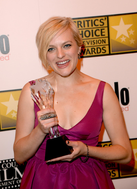 ". Actress Elisabeth Moss wins the award for Best Actress in a Movie or Miniseries for ""Top of the Lake\"" at the Broadcast Television Journalists Association\'s third annual Critics\' Choice Television Awards at The Beverly Hilton Hotel on June 10, 2013 in Los Angeles, California.  (Photo by Jason Merritt/Getty Images for CCTA)"