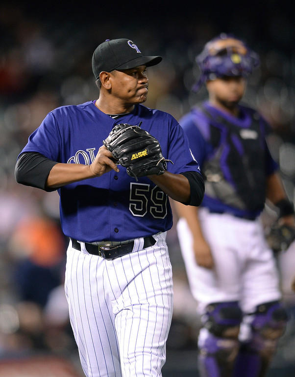 . Colorado reliever Wilton Lopez left the game in the eighth inning after a disastrous performance. The Colorado Rockies hosted the Chicago White Sox Tuesday night, April 8, 2014 at Coors Field in Denver.  (Photo by Karl Gehring/The Denver Post)