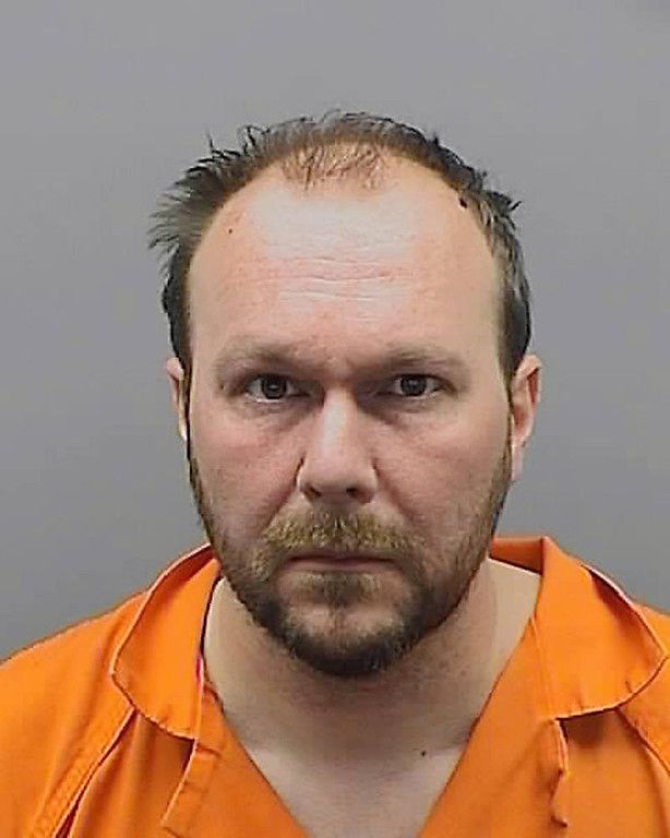 . An Oct. 7, 2012 handout photo from the Southfield, Mich., police,  shows Todd Kettler, 37, in a booking mug. Kettler was arrested after money stolen in a bank robbery and covered in red dye was used at a southwest Michigan strip club.  Kettler was arrested Sunday after the manager of a Kalamazoo Township strip club called police because a man was passing out dye-covered cash. (AP Photo/Southfield Police, HOPD)