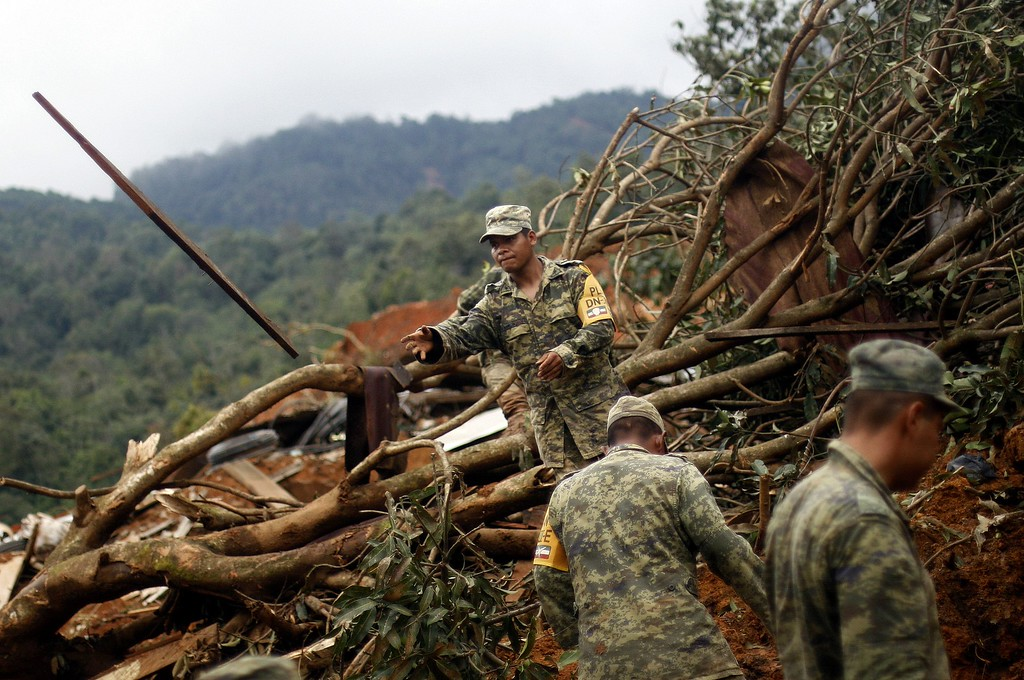 . Mexican soldiers work on the site of a landslide in La Pintada, state of Guerrero, Mexico, on September 19, 2013 as heavy rains hit the country. AFP PHOTO/Pedro PARDO/AFP/Getty Images