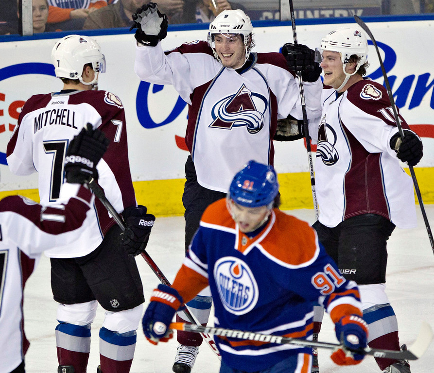 . Colorado Avalanche\'s John Mitchell, from left, Matt Duchene and Jamie McGinn celebrate Duchene\'s goal as Edmonton Oilers\' Magnus Paajarvi skates past during the second period  of an NHL hockey game in Edmonton, Alberta, Saturday, Feb. 16, 2013. (AP Photo/The Canadian Press, Jason Franson)