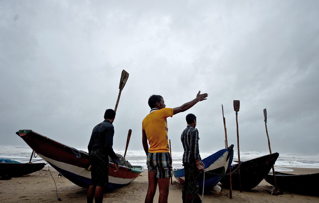 . Indian fishermen gesture as they secure their boats along the shore at Donkuru village, in the Srikakulam district on October 12, 2013.   Nearly half a million people have been evacuated from India\'s impoverished east coast ahead of a massive cyclone expected to make landfall on October 12  evening, disaster officials said. MANAN VATSYAYANA/AFP/Getty Images