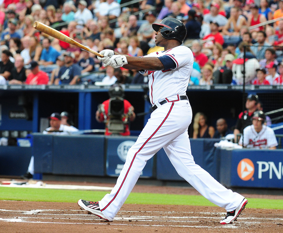 . Justin Upton #8 of the Atlanta Braves hits a two run first inning home run against the Colorado Rockies at Turner Field on August 1, 2013 in Atlanta, Georgia. (Photo by Scott Cunningham/Getty Images)