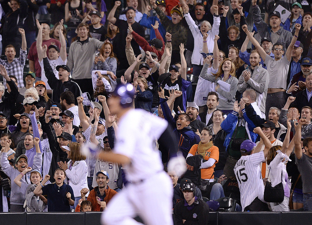 . Rockies fans jumped out of their seats after Nolan Arenado doubled to drive in two runs in the bottom of the ninth inning.    (Photo by Karl Gehring/The Denver Post)