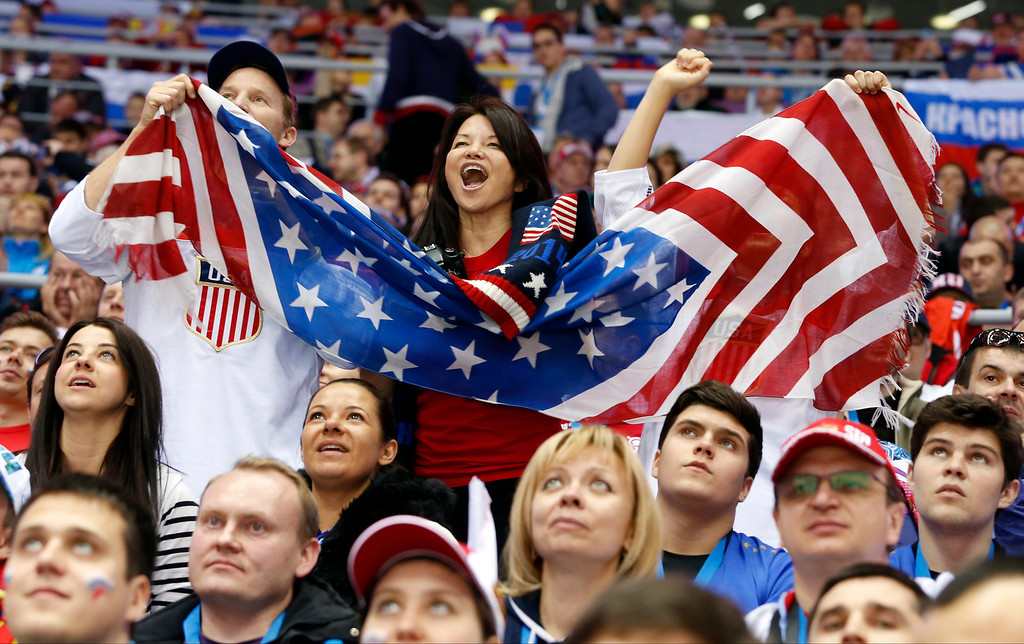 . US fans cheer a second period goal by the USA against Russia during a men\'s ice hockey game at the 2014 Winter Olympics, Saturday, Feb. 15, 2014, in Sochi, Russia. (AP Photo/Mark Humphrey)