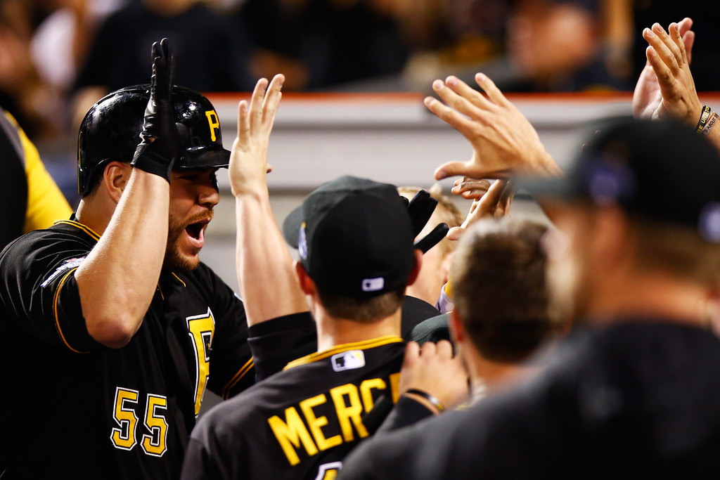 . PITTSBURGH, PA - OCTOBER 01:  Russell Martin #55 of the Pittsburgh Pirates celebrates his solo home run with teammates in the second inning against the Cincinnati Reds during the National League Wild Card game at PNC Park on October 1, 2013 in Pittsburgh, Pennsylvania.  (Photo by Jared Wickerham/Getty Images)