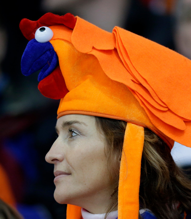 . A fan wears a hat supporting Netherlands during the women\'s 3,000-meter speed skating competition at the 2014 Winter Olympics, Sunday, Feb. 9, 2014, in Sochi, Russia. (AP Photo/David J. Phillip )