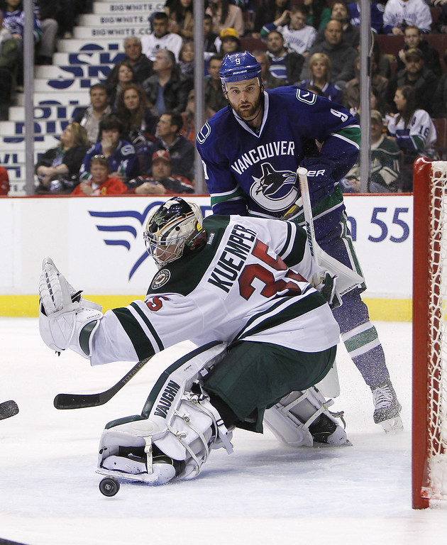 . Goaltender Darcy Kuemper #35 of the Minnesota Wild makes a save against Zack Kassian #9 of the Vancouver Canucks during the second period of their NHL game at Rogers Arena on February 28, 2014 in Vancouver, British Columbia, Canada. (Photo by Ben Nelms/Getty Images)