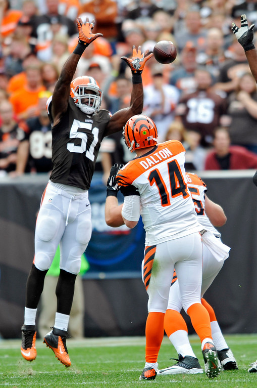 . Cleveland Browns linebacker Barkevious Mingo (51) tips a pass from Cincinnati Bengals quarterback Andy Dalton (14) in the second quarter of an NFL football game on Sunday, Sept. 29, 2013, in Cleveland. The pass was eventually caught by Bengals tight end Tyler Eifert. (AP Photo/David Richard)