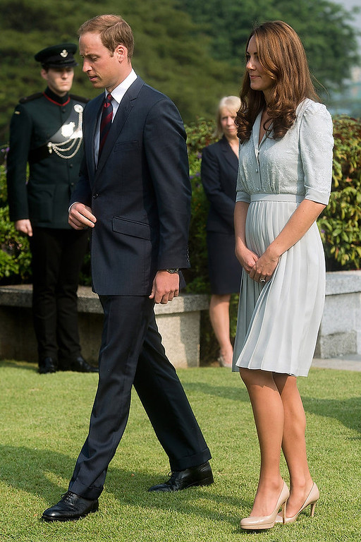 . Britain\'s Prince William and his wife Kate, the Duke and Duchess of Cambridge, walk together as they visit the Kranji Commonwealth War Memorial in Singapore on Sept. 13, 2012. Prince William and his wife Catherine are expecting their first child.  St. Jamesís Palace announced the pregnancy Monday, saying that the Duchess of Cambridge, formerly known as Kate Middleton has a severe form of morning sickness and is currently in a London hospital. William is at his wife\'s side.  (AP Photo/Nicolas Asfouri)