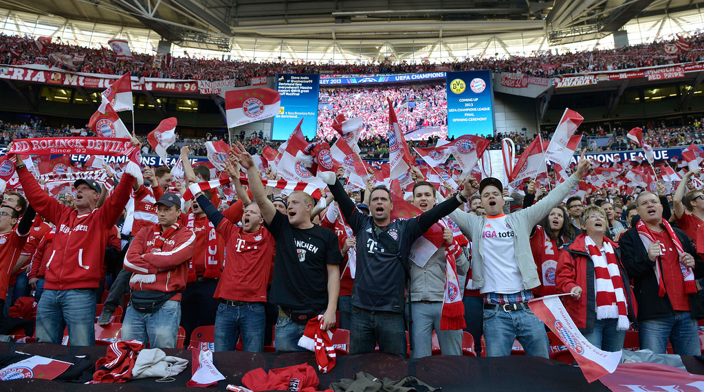 . Bayern Munich supporters react, ahead of the Champions League Final soccer match between Borussia Dortmund and Bayern Munich at Wembley Stadium in London, Saturday May 25, 2013. (AP Photo/Martin Meissner)
