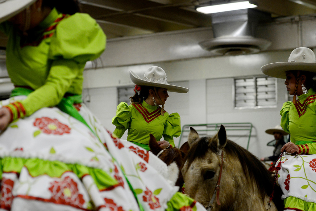 . Riders prepare to take the arena floor National Western Stock Show\'s Mexican Rodeo Extravaganza at the Denver Coliseum on Sunday, Jan. 13, 2013. AAron Ontiveroz, The Denver Post
