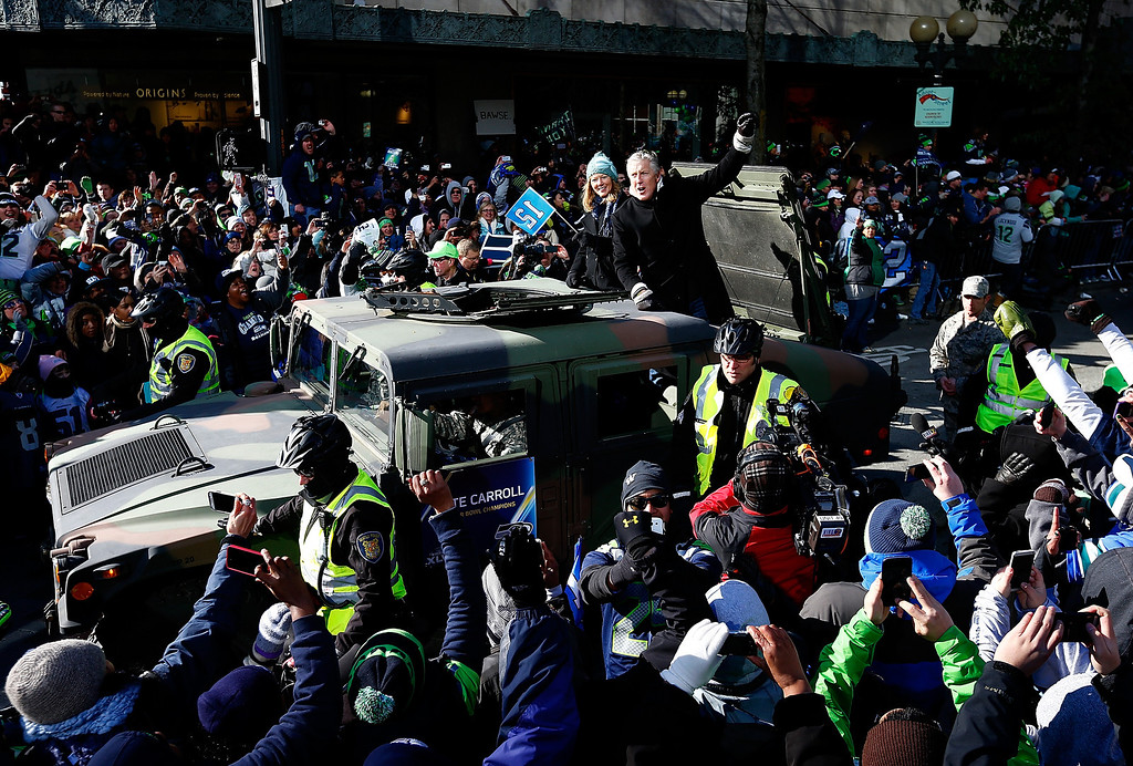 . Head coach Pete Carroll of Seattle Seahawks waves to fans during a parade to celebrate their victory in Super Bowl XLVII on February 5, 2014 in Seattle, Washington.  (Photo by Jonathan Ferrey/Getty Images)