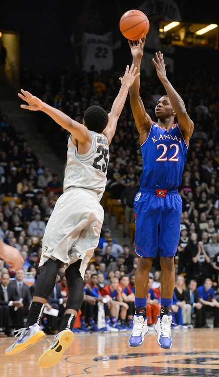 . Kansas guard, Andrew Wiggins, right, shoots over Colorado University point guard, Spencer Dinwiddie, in the first half play at the Coors Events Center in Boulder Colorado Saturday afternoon, December 07, 2013. (Photo By Andy Cross/The Denver Post)