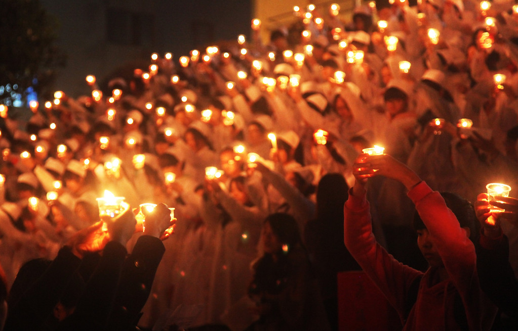 . HENGNAN, CHINA - APRIL 24:  (CHINA OUT) Students of University of South China light candles to pray for quake victims on April 24, 2013 in Hengnan, China. A powerful earthquake struck the steep hills of China\'s southwestern Sichuan province on the morning of April 20, leaving at least 196 people dead and more than 12,200 injured.  (Photo by ChinaFotoPress/ChinaFotoPress via Getty Images)