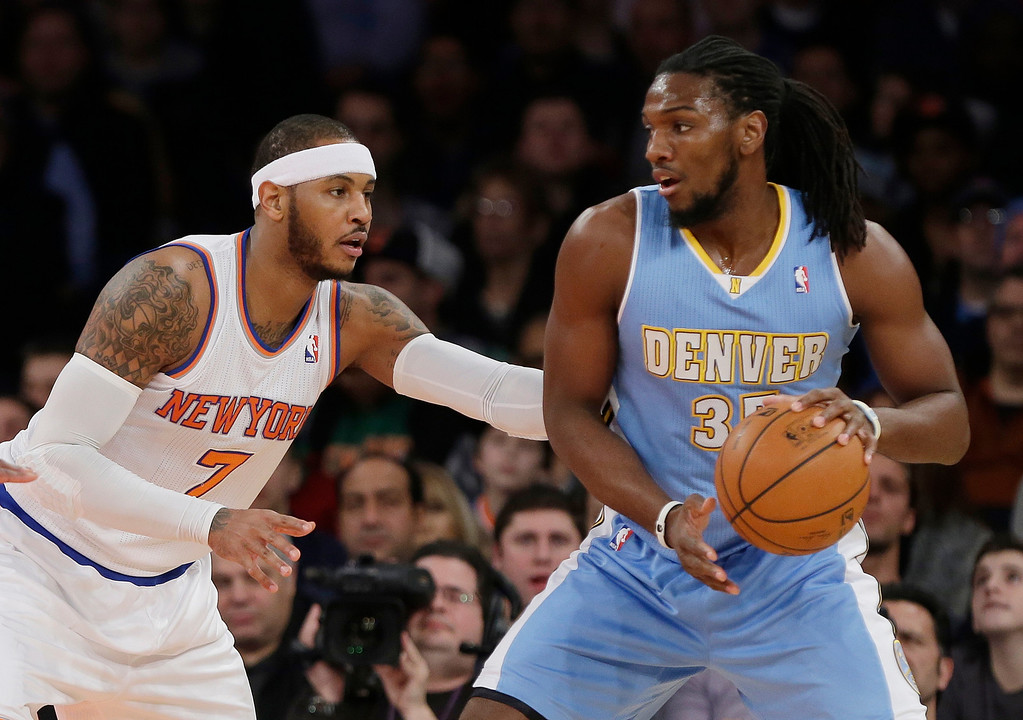 . New York Knicks\' Carmelo Anthony (7) defends Denver Nuggets\' Kenneth Faried (35) during the first half of an NBA basketball game Friday, Feb. 7, 2014, in New York. (AP Photo/Frank Franklin II)