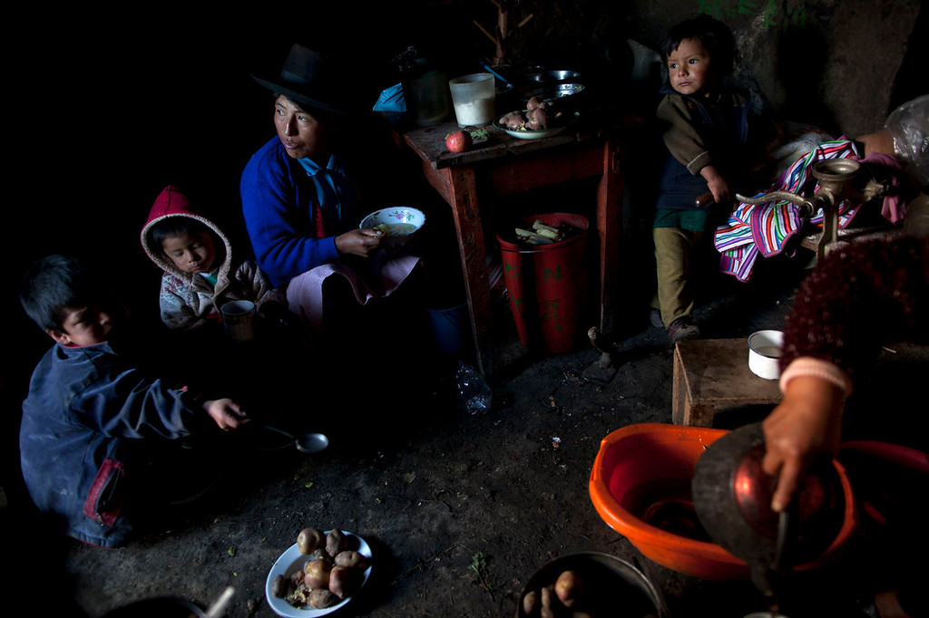 . A family eats lunch a day after a mass burial in Chaca, Peru. Relatives and friends joined to formally bury the remains of 21 people slain by insurgents nearly three decades ago. Their remains were exhumed from a common grave last year in the remote region of Ayacucho state that endured some of the worst atrocities of Peru\'s 1980-2000 conflict. Both security forces and Maoist-inspired insurgents committed grave human rights violations.   (AP Photo/Rodrigo Abd)