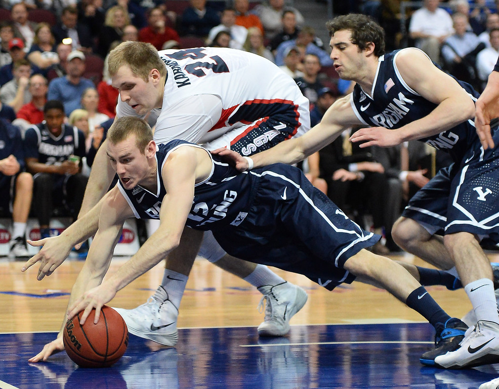 . Josh Sharp #12 of the Brigham Young Cougars and Przemek Karnowski #24 of the Gonzaga Bulldogs go after a loose ball during the championship game of the West Coast Conference Basketball tournament at the Orleans Arena on March 11, 2014 in Las Vegas, Nevada.  (Photo by Ethan Miller/Getty Images)