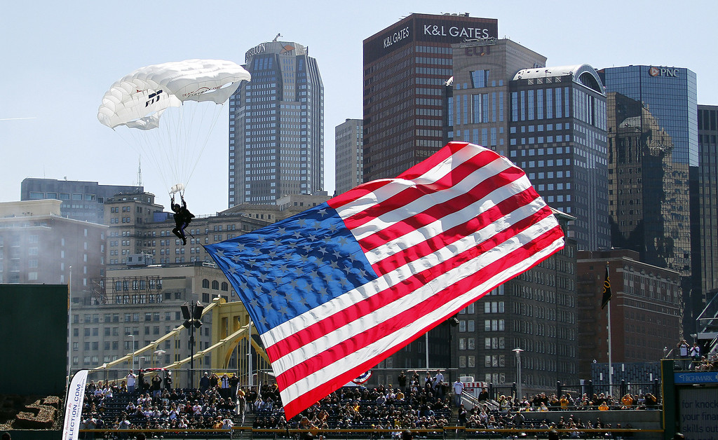 . Parachuters fly into the ballpark during pre game ceremonies before the game between the Chicago Cubs and the Pittsburgh Pirates during Opening Day at PNC Park on March 31, 2014 in Pittsburgh, Pennsylvania.  (Photo by Justin K. Aller/Getty Images)