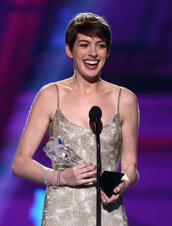 ". Anne Hathaway accepts the award for best supporting actress for ""Les Miserables\"" at the 18th Annual Critics\' Choice Movie Awards at the Barker Hangar on Thursday, Jan. 10, 2013, in Santa Monica, Calif.  (Photo by Matt Sayles/Invision/AP)"