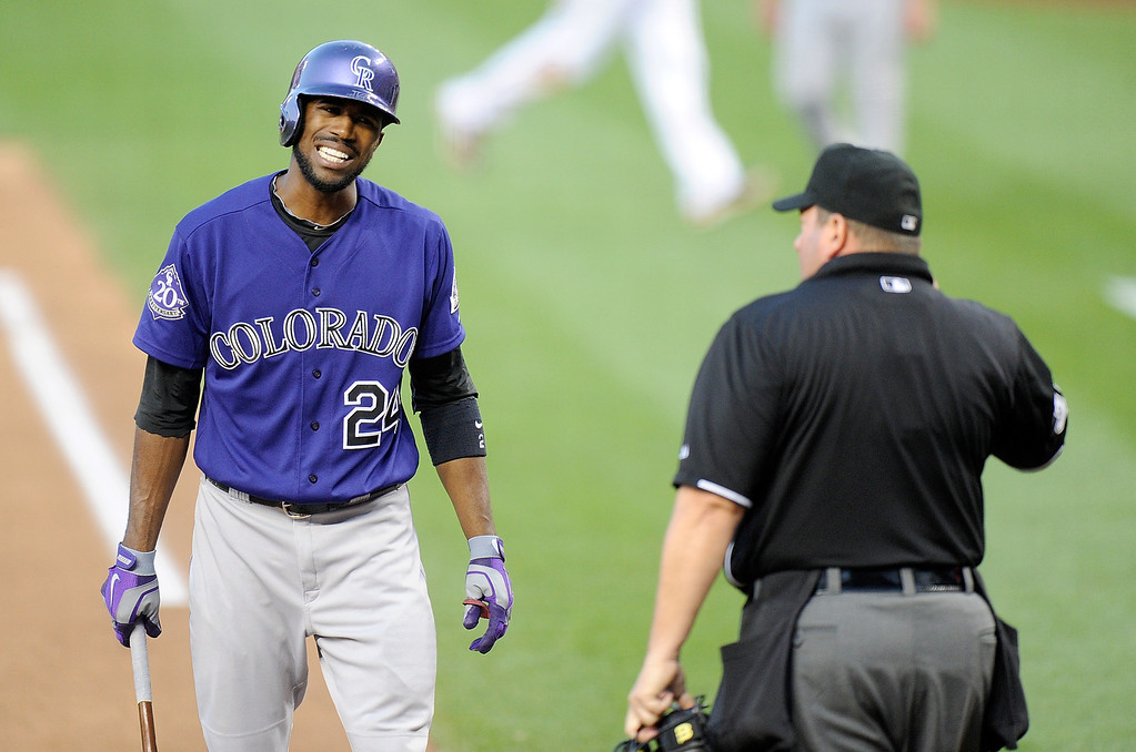 . Dexter Fowler #24 of the Colorado Rockies argues with home plate umpire Sam Holbrook after a called third strike in the fifth inning against the Washington Nationals at Nationals Park on June 21, 2013 in Washington, DC.  (Photo by Greg Fiume/Getty Images)