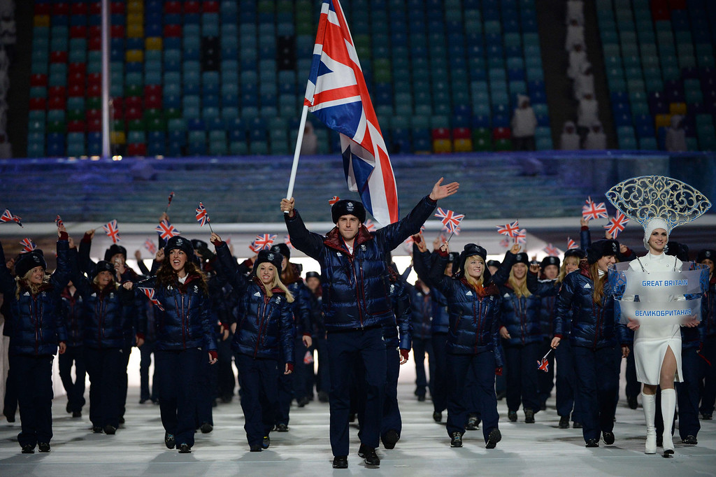 . Great Britain\'s flag bearer, speed skater Jon Eley leads his national delegation during the Opening Ceremony of the Sochi Winter Olympics at the Fisht Olympic Stadium on February 7, 2014 in Sochi. AFP PHOTO / ANDREJ ISAKOVIC/AFP/Getty Images