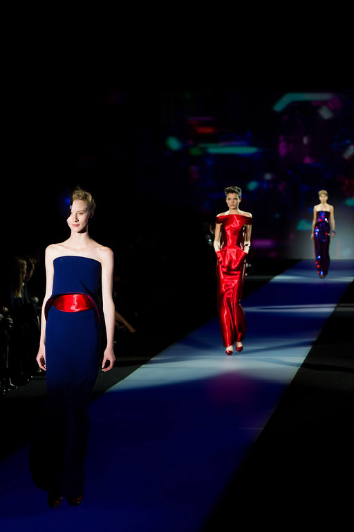 ". Models walk the runway during Giorgio Armani\'s ""One Night Only New Yorkî fashion show on Thursday, Oct. 24, 2013 in New York. (Photo by Charles Sykes/Invision/AP)"