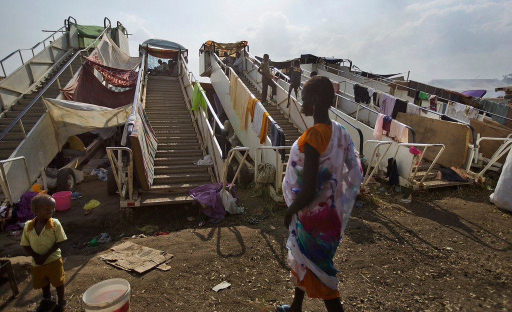 . Moveable stairs used for passengers to board aircraft are repurposed into makeshift shelters by the displaced at a United Nations compound which has become home to thousands of people displaced by the recent fighting, in the capital Juba, South Sudan Sunday, Dec. 29, 2013. Some 25,000 people live in two hastily arranged camps for the internally displaced in Juba and nearly 40,000 are in camps elsewhere in the country, two weeks after violence broke out in the capital and a spiraling series of ethnically-based attacks coursed through the nation, killing at least 1,000 people. (AP Photo/Ben Curtis)