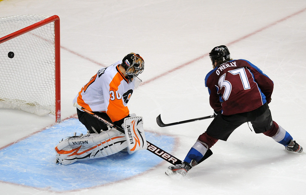 . Colorado Avalanche center Ryan O\'Reilly, right, scores the game-winning goal against Philadelphia Flyers goalie Ilya Bryzgalov, of Russia, in an overtime shootout in an NHL hockey game on Monday, Dec. 19, 2011, in Denver. The Avalanche won 3-2 in an overtime shootout. (AP Photo/Chris Schneider)