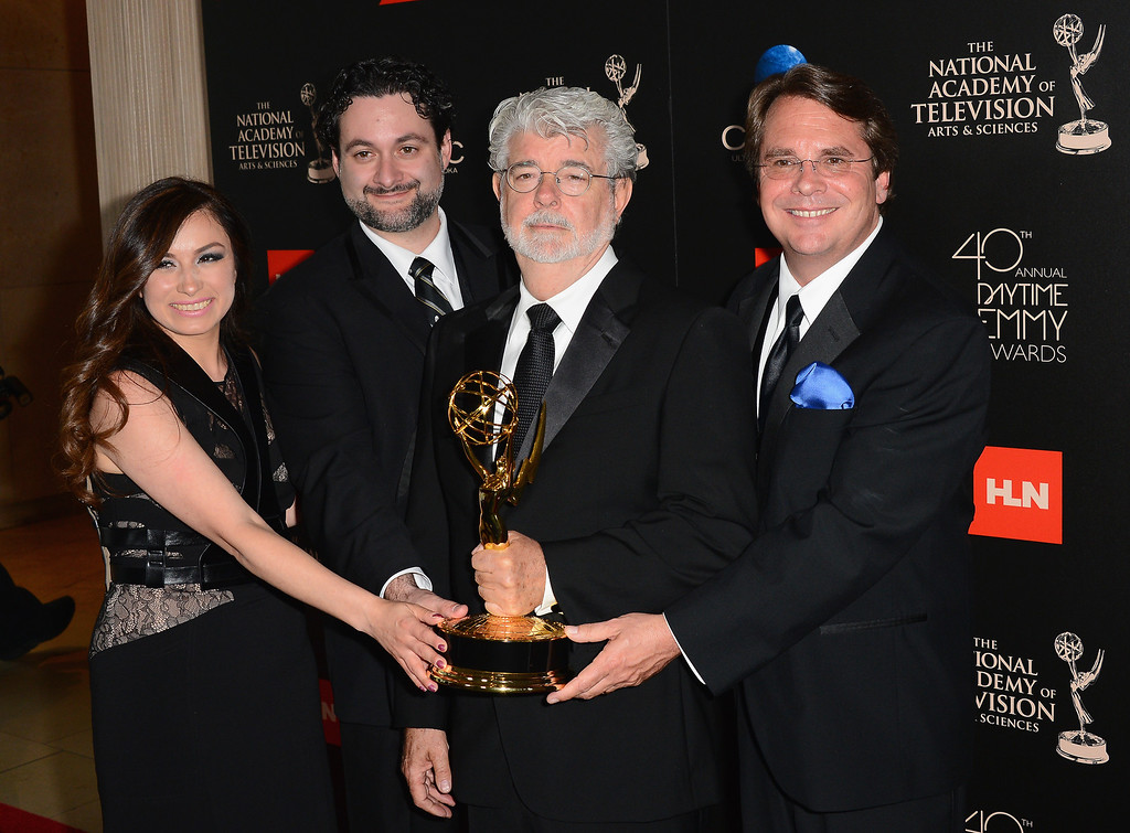 ". (L-R) Athena Portillo, Dave Filoni, George Lucas and Cary Silver pose with the Outstanding Special Class Animated Program award for ""Star Wars: The Clone Wars\"" in the press room during The 40th Annual Daytime Emmy Awards at The Beverly Hilton Hotel on June 16, 2013 in Beverly Hills, California.  (Photo by Mark Davis/Getty Images)"