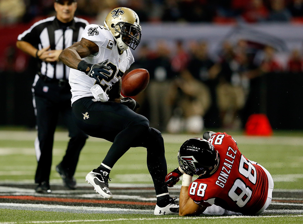 . Free safety Malcolm Jenkins #27 of the New Orleans Saints breaks up a pass intended for tight end Tony Gonzalez #88 of the Atlanta Falcons during a game at the Georgia Dome on November 21, 2013 in Atlanta, Georgia.  (Photo by Kevin C. Cox/Getty Images)