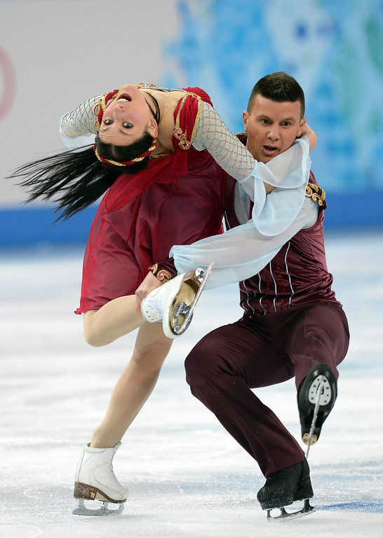 . Italy\'s Charlene Guignard and Italy\'s Marco Fabbri perform in the Figure Skating Team Ice Dance Free Dance at the Iceberg Skating Palace during the Sochi Winter Olympics on February 9, 2014.    YURI KADOBNOV/AFP/Getty Images